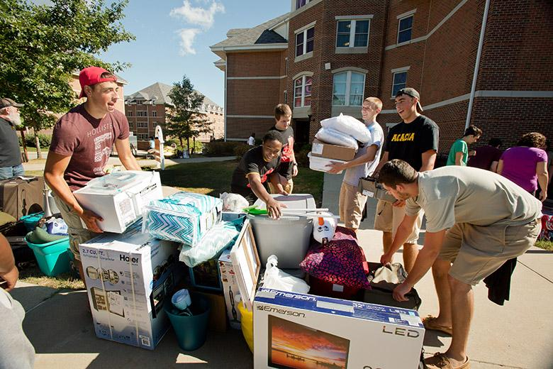 Members of Acacia and Tau Kappa Epsilon fraternities help move new students into the Cal U residence halls during the annual Move-In Day.