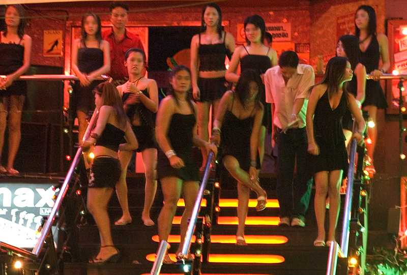 Prostitutes in front of a gogo bar in Pattaya, Thailand. Like slaves on an auction block waiting to be selected, victims of human trafficking have to perform as they are told or risk being beaten. Sex buyers often claim they had no idea that most women and girls abused in prostitution are desperate to escape, or are there as a result of force, fraud, or coercion. (Source; WikiMedia)