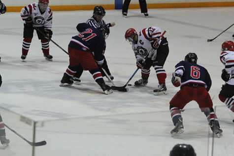 Vulcans and Colonials players battle off a faceoff during the Vulcans win. Cal 1 has won every year for the Cal U Hockey Homecoming Series