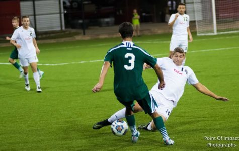 Brad Powell, 14, slide tackles a Slippery Rock player.