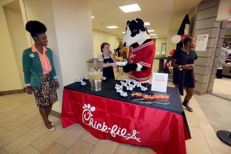 The marketing team hands out samples of lemonade as students wait in line for Chick-fil-A.