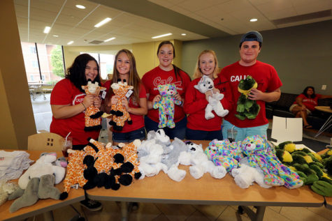Members of the Student Activities Board show off their Stuff-A-Buddies.