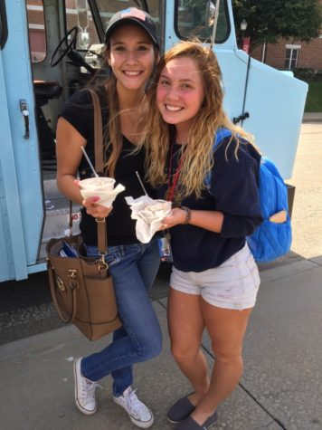 Two students enjoy their free ice cream.