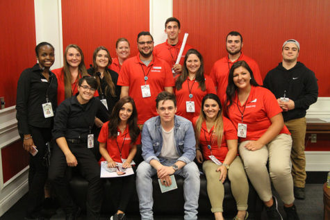The Convocation Center staff takes a quick break to get a photo with Jesse McCartney.