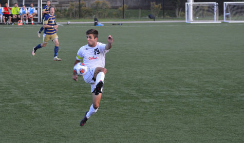 Senior, Cory Kuzilla, prevents the ball from getting past him.