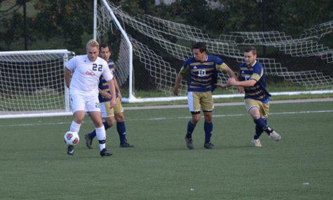 Senior, Nick Cichon, battles around three Pitt-Johnstown players.