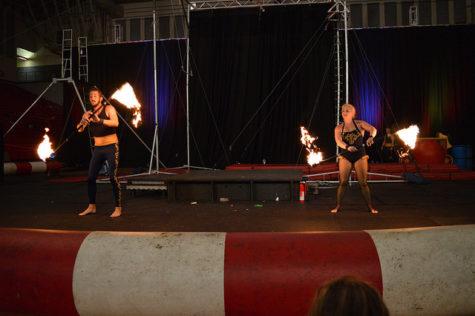 Two members of the Cincinnati Circus Company juggle fire.