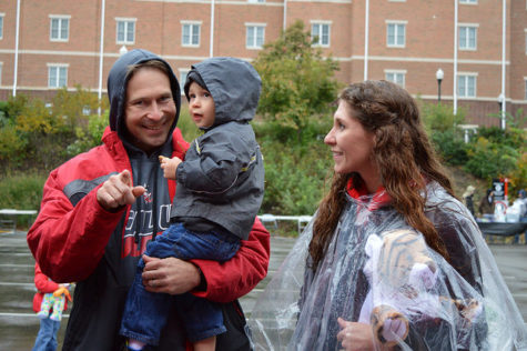 Professor JP Staszel and his family enjoy the homecoming pre-parade festivities.