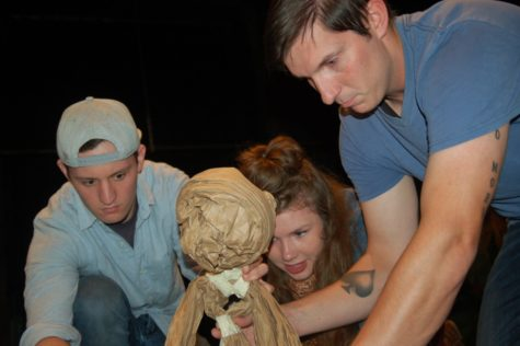 LaMedica and senior, Tristan Bartolomucci, work on making their puppet move.
