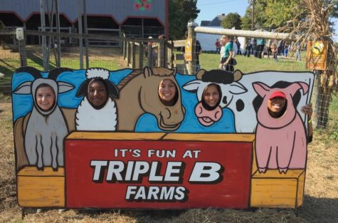 Students mess around with the photo props at Triple B Farms.