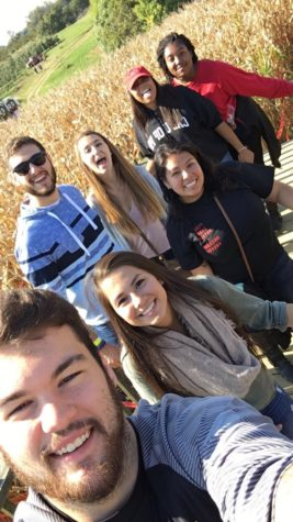 Students take a break from trying to find their way out the corn maze.