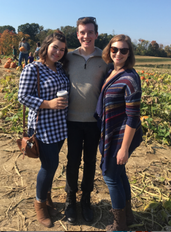 Enjoying their time at the pumpkin patch, juniors Sidney Popielarcheck, Mark Barret and Kayla Grimm take a photo.