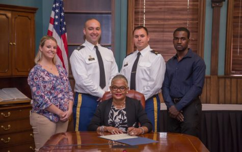 """Cal U President Jones signs a proclamation recognizing Nov. 7-11 as """"Military and Veterans Appreciation Week"""""""