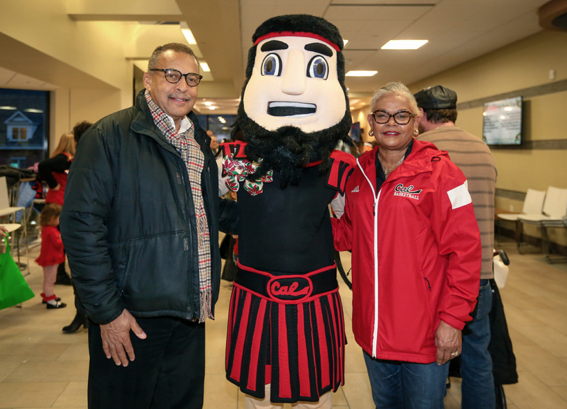 President Jones and her husband stand with Blaze at the second annual Holly Day.