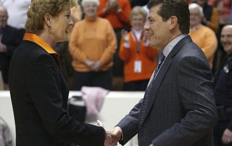 UCONN women's basketball coach, Geno Auriemma, and Tennessee women's basketball coach, Pat Summitt, shake hands.