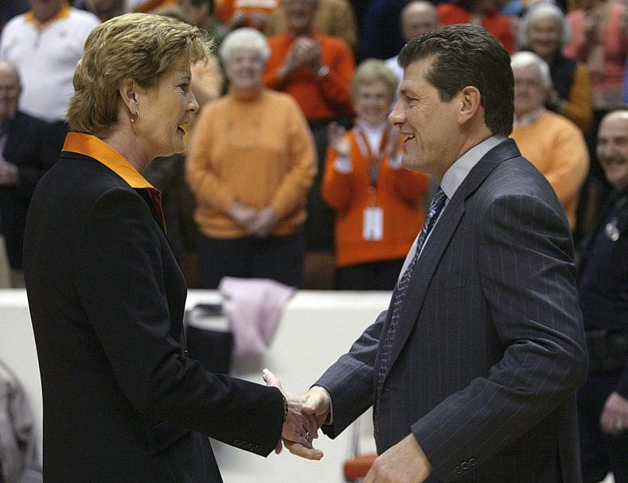 UCONN women's basketball coach, Geno Auriemma, and Tennessee women's basketball coach, Pat Summitt, shake hands.