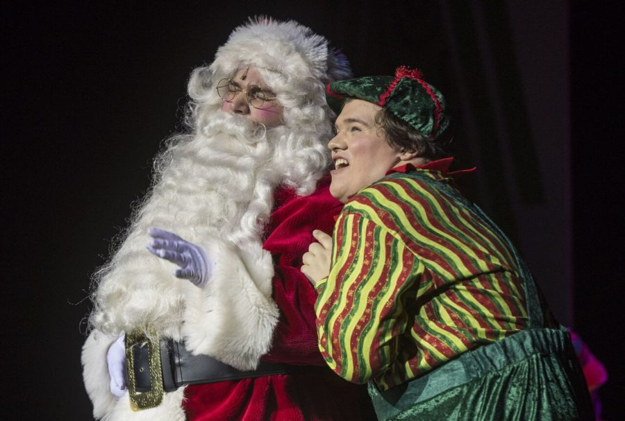 Senior, Nick Franczak, and sophomore, Jeshua Myers, share a moment on stage as Santa and Eubie.