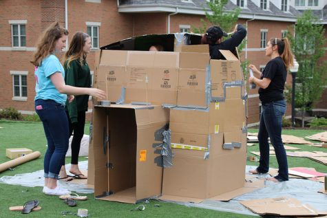 Members of Sigma Kappa begin building their igloo for the
