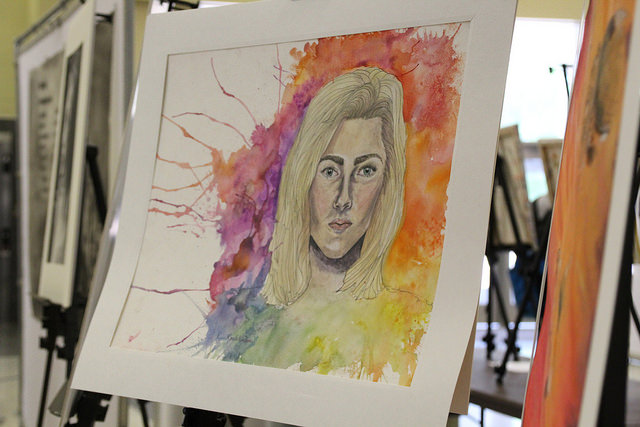 A student's art is displayed in the Convocation Center for the Strike a Spark conference.