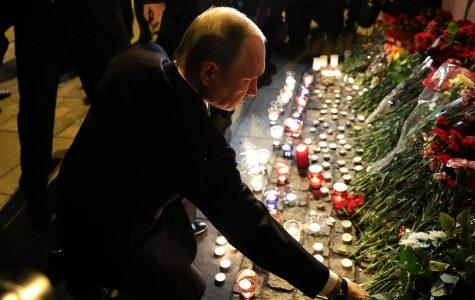 Russian Primer Minister, Vladimir Putin, lays down flowers at makeshift memorial for the St. Petersburg metro bombing victims.