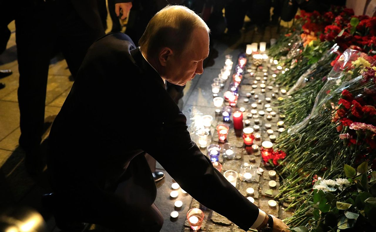 Russian Primer Minister, Vladimir Putin, lays down flowers at makeshift memorial for the St. Petersburg metro bombing victims.