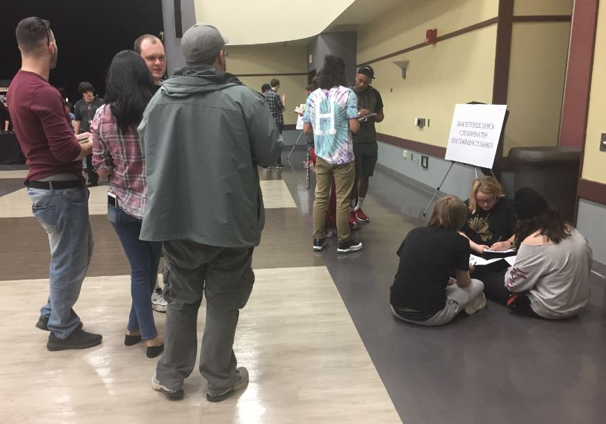 Students sit down and try to put all of the clues together during the Escape Room event.