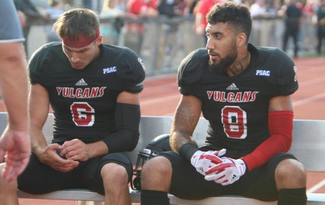 Luke Smorey (6) and Tom Greene (8) talk on the sidelines at Adamson Stadium on August 31. Smorey and Greene are both senior wide receivers.