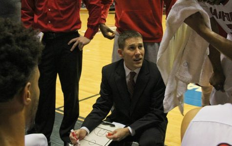 Kent McBride, center, goes over plays with last year's Cal U Men's Basketball Team. This year, the team will introduce six new players.