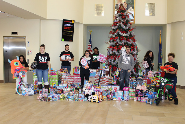 Members of student government pose with the toys donated for Toys for Tots.