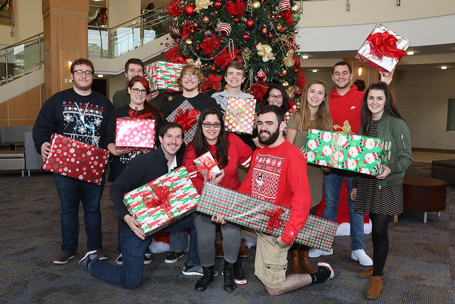 The members of the Cal Times staff pose for their Christmas photo for the December 8, 2017, issue of the Cal Times. In the front row, left to right: Tristan Bartolomucci, Rachael McKriger and Colin Kirkwood. In the second row, from left to right: Brad Britvich, Melissa Petruzzi, James Rudolph, Taylor Barta, Jeromy Mackey, Mari Boyle, Jessica Crosson, Danny Beeck and Olivia Wilson.