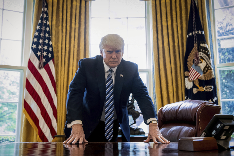 Photo of President Donald j. Trump in the Oval Office courtesy of Andrew Harnik/Associated Press.