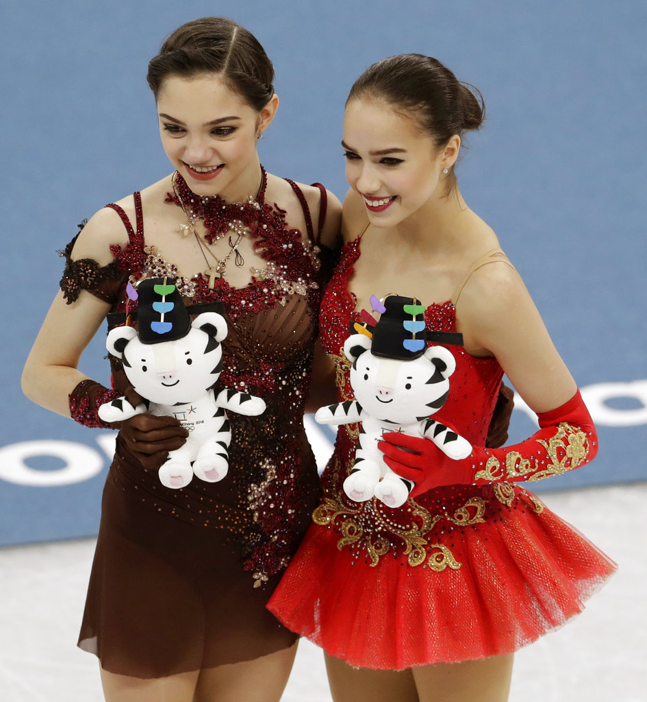 Photo of gold medalist Alina Zagitova, right, and silver medalist Yevgenia Medvedeva of Russia courtesy of Petr David Josek/Associated Press.