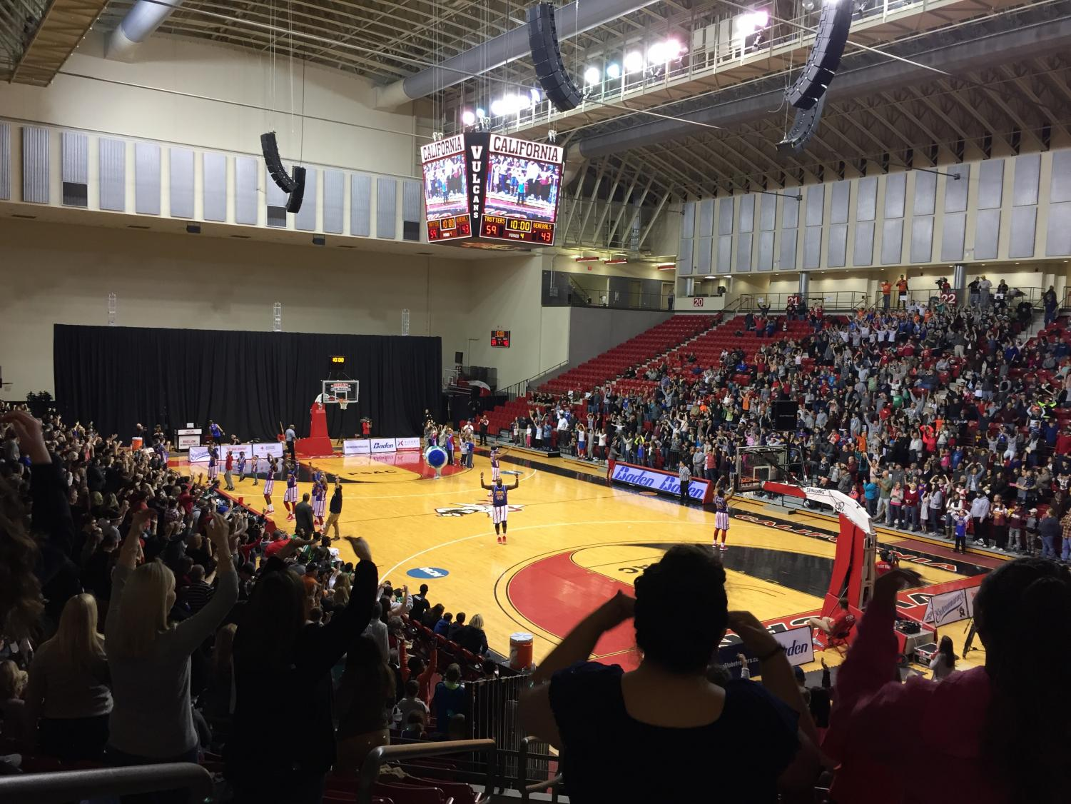 The Harlem Globetrotters lead the audience in the YMCA.
