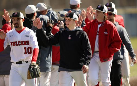 Carter Krick high fives his teammates at the Washington Wild Things Park ater Cal U defeated West Liberty, 7-6, in Game 1 on March 5.