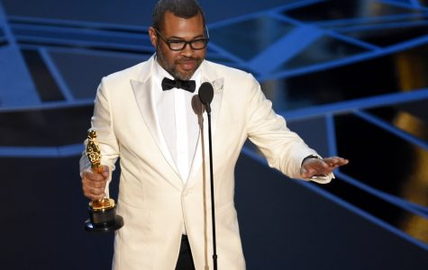 Photo of Jordan Peele accepting his Oscar for Best Screenplay for