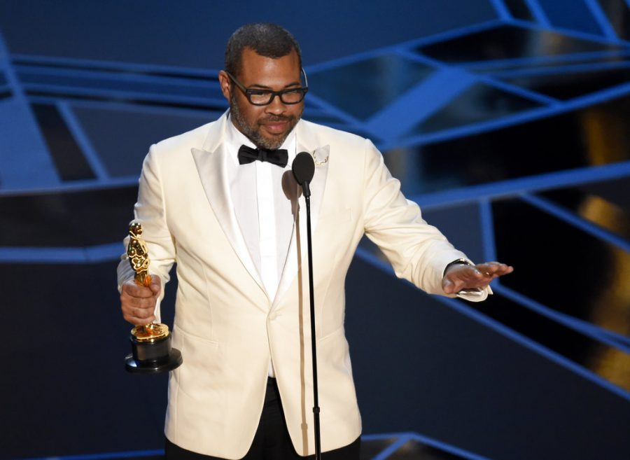 Photo+of+Jordan+Peele+accepting+his+Oscar+for+Best+Screenplay+for+%22Get+Out%22+courtesy+of+Chris+Pizzello%2FInvision%2FAP.