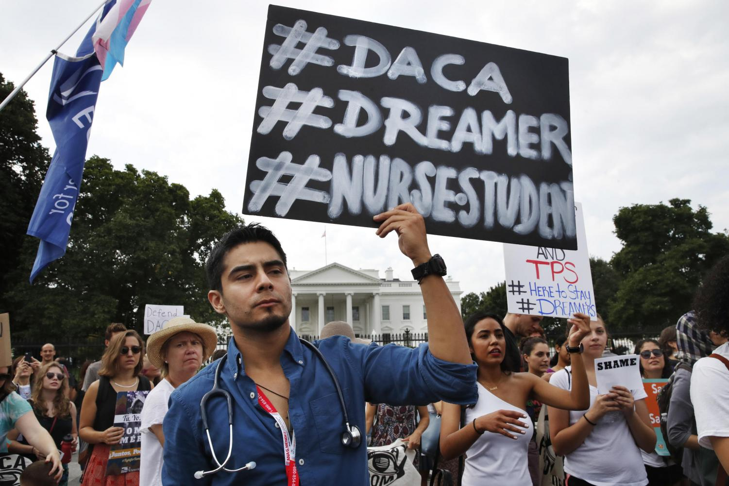 Carlos Esteban, 31, of Woodbridge, Virginia, a nursing student and recipient of Deferred Action for Childhood Arrivals, known as DACA, rallies with others in support of DACA outside of the White House Tuesday. Photo by Jacquelyn Martin/Associated Press.