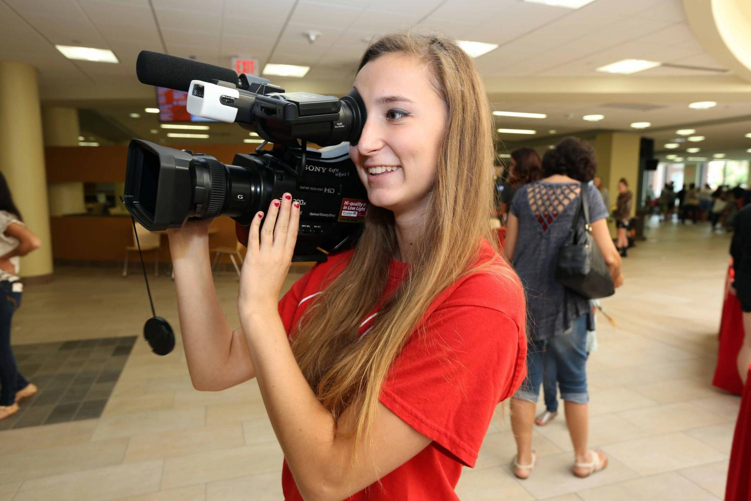 Jessica Crosson captures video at Cal U Family Day.