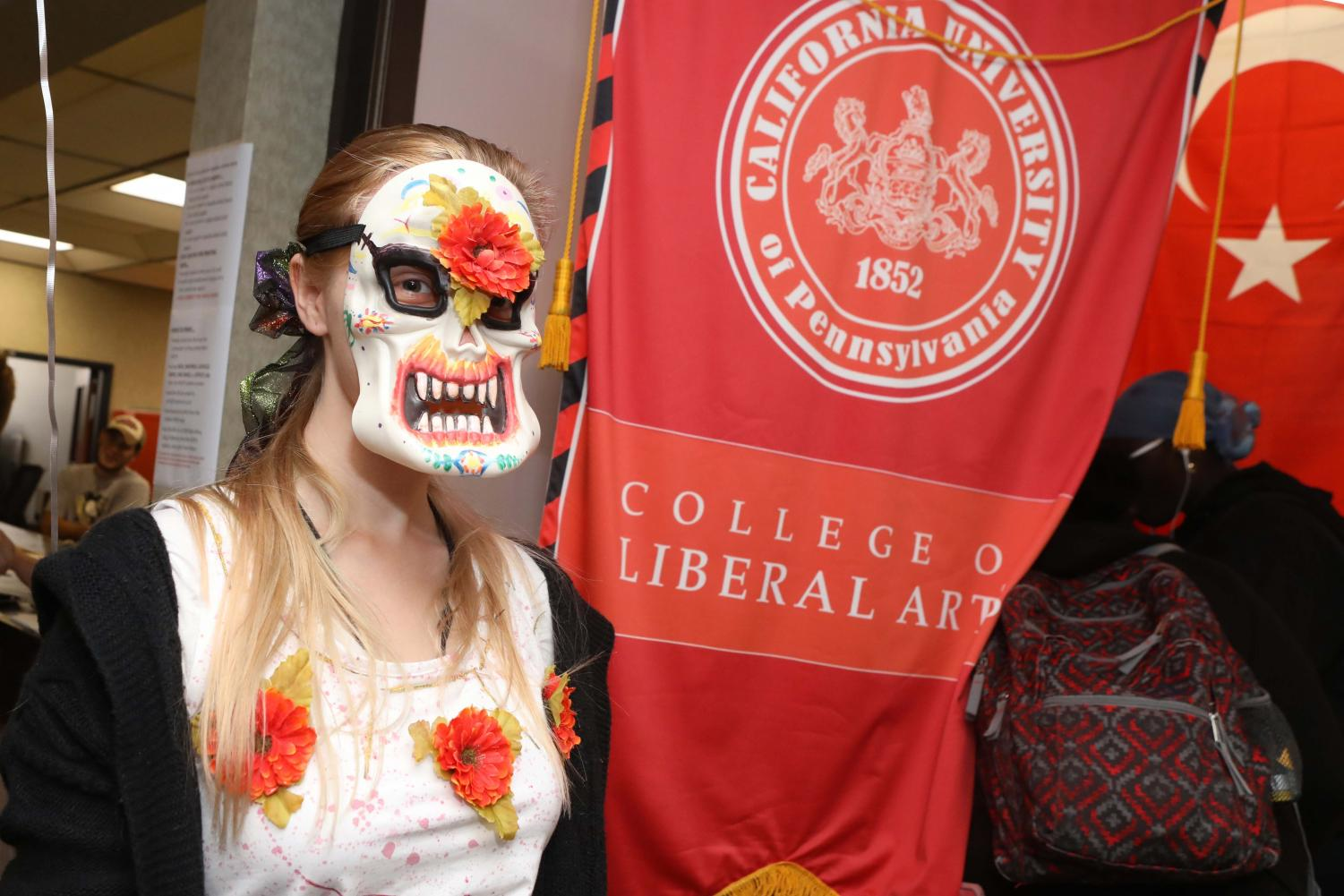 """(Oct. 2, 2018) Amber Meister, sophomore, wears a mask depicting Mexican culture """"Day of the Dead"""" and pagan holiday for  """"All Hallows Eve"""