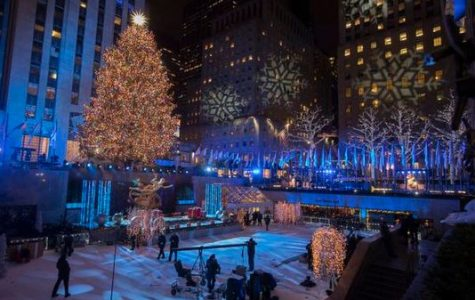 Rockefeller Center Tree Lights up NYC Skyline