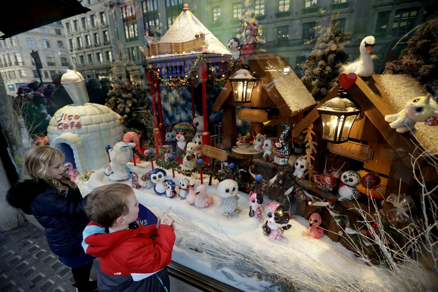 Children look at the newly unveiled Hamleys toy store Christmas window display which features Ty cuddly plush toys, on Regent Street in  London, Friday, Nov. 2, 2018.