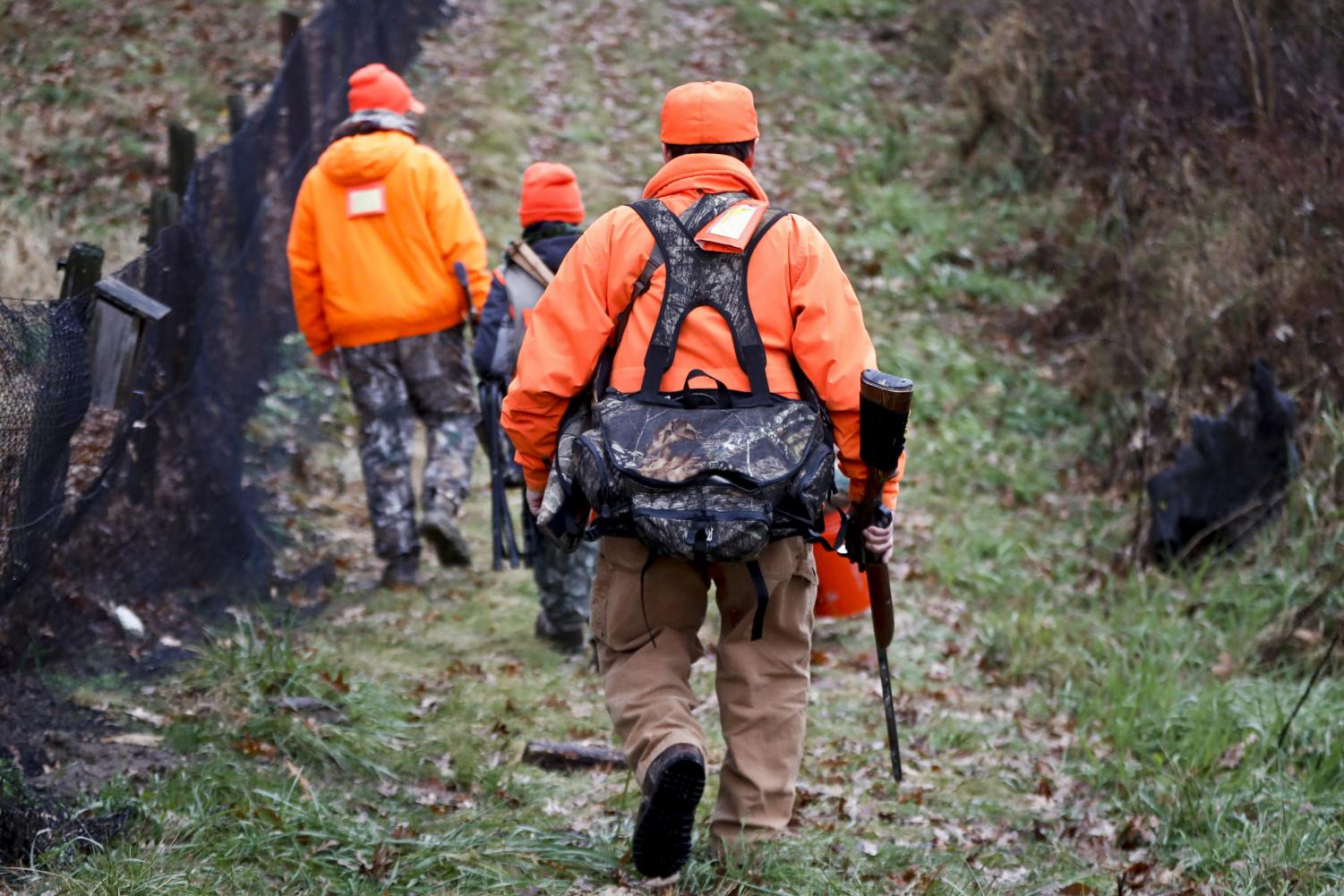 Santo Cerminaro, right, follows his son, Dominick Cerminaro, left, and grandson, Santo Cerminaro, 11, into the woods to go deer hunting on the first day of regular firearms deer hunting season, in most of Pennsylvania, Monday, Nov. 26, 2018 in Zelienople, Pa.