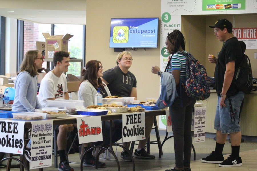 Members of Cal U's S.T.A.N.D. organization offering free cookies to visitors in the Natali Student Center during back-to-school week, 2019