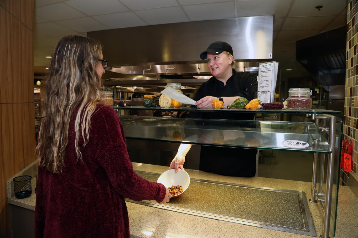"Executive Chef Jennifer Richmond works with Cal U student Miranda Anderson to customize an allergen-friendly meal at the Gold Rush dining hall's new ""Clarity"" station, Natali Student Center."
