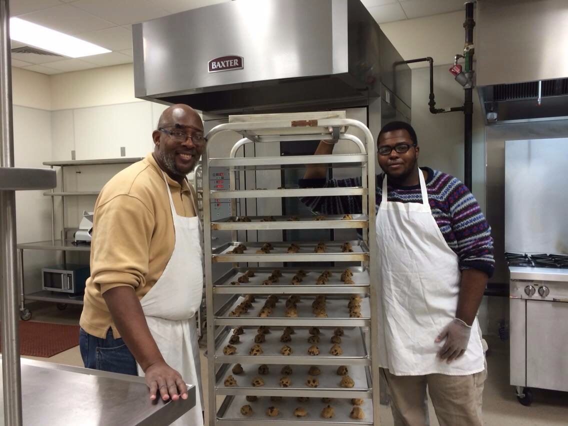 Jerron Corley, on right, uses his entrepreneurial skills to launch his own cookie-making business