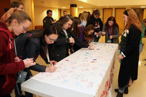 Members of Cal U fraternities, sororities, sports clubs and others gathered in the Steele Auditorium lobby on Feb. 23, 2020, to sign a banner pledging not to participate in hazing activities.  The banner will be on display in the Natali Student Center.