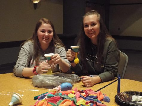 Breal Savage and Kaydee Taylor fill balloons with flour to make stress balls for Special Olympic athletes.
