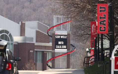 A sign on the Cal U Convocation Center advises all to