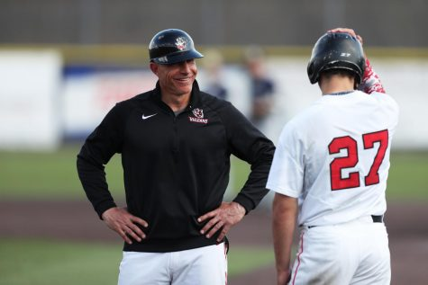 Cal U Head Baseball Coach Mike Conte talks to a player at a home game versus UPJ at Washington Wild Things Park on April 6, 2019.
