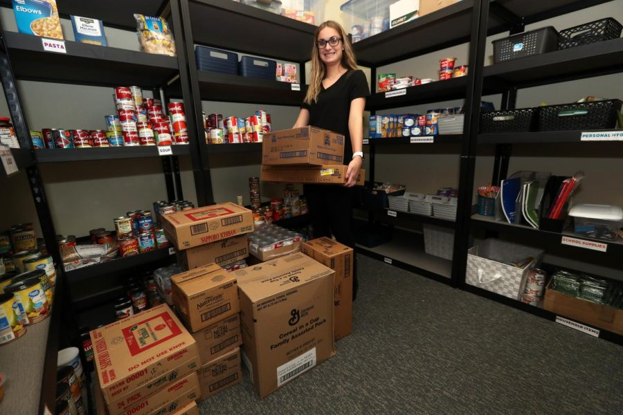 Miranda Anderson helps to deliver a food donation from AVI Foodsystems to the Cal U Cupboard student food pantry, Dec. 9, 2019.